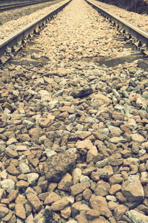 Background with gravel and railroad line. Old railroad. toned. vertical photo 免版税图像