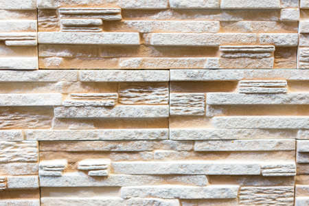 Stacked stone wall, natural stone cladding. Stone wall for background,Slab stone wall texture. Wall background of volcanic andesite basalt stone texture 免版税图像