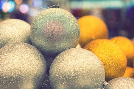 Golden Christmas balls, Christmas toys. Christmas tree decoration toys. Christmas concept. toned