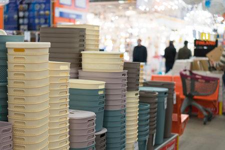 Plastic crates in a hardware store. Фото со стока