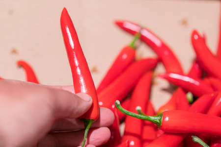 Man buys a hot red peppers in the store.