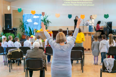 People praying in a church. soft focus of christian people group raise hands up worship God Jesus Christ together in church
