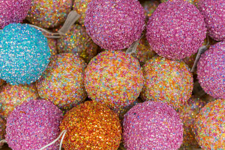 Pile of glass,christmas ornaments in various colors. Colorful Christmas balls, Closeup. Decorations for the holiday. Multicolored balls. Christmas decorations. New Year. Christmas Фото со стока