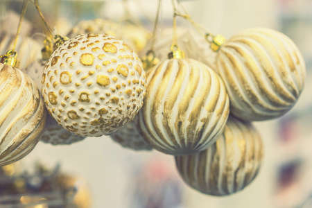 beautiful golden christmas balls on a golden background. Christmas balls close up picture