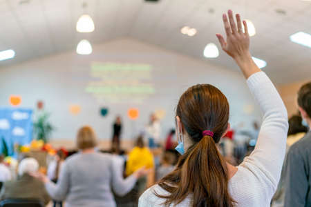 People praying in a church. soft focus of christian people group raise hands up worship God Jesus Christ together in church. selected focus 免版税图像