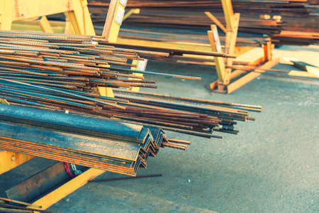 stack of steel pipe and metal beams on rack. metal pipes, profiles, rods, corners, rails, a choice of metal products. Metal shop. toned