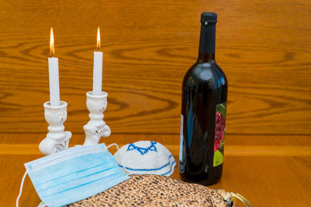 Dust mask, bottle of wine and matzah - a traditional Jewish food for Passover.