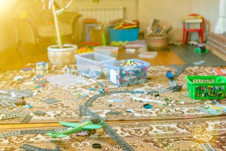 Games floor for preschoolers kindergarten. interior children's room. mess in the room. mess in the children's room, scattered toys, boxes on the floor. toned.
