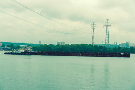 Beautiful barges from a height float on the river. The barge floats on the Dnieper river in Kiev. toned.
