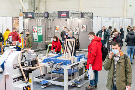 Kiev, Ukraine March 5 2021. Furniture exhibition during a pandemic. international furnishing accessories exhibition. Equipment for the production of furniture. Exhibition and social distance