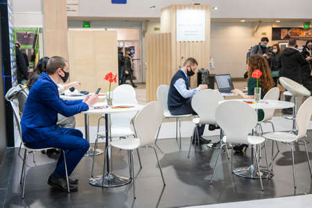 Kiev, Ukraine March 18 2021. international building exhibitionduring a pandemic. Equipment for construction and repair. Business meetings at the exhibition. Exhibition and social distance.