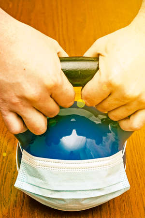 Iron kettlebell in the mans hand on a wooden background. Close up. Sports kettlebell in the gym, top view. kettlebells on gym. Close up. Sports kettlebell in the gym, top view. toned