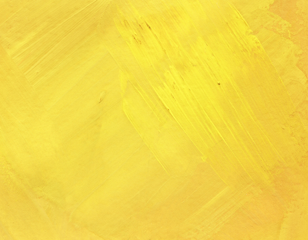 Yellow hand painted abstract background. Greasy smears of oil on the surface. Spring, summer sunny.