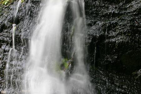 A small cataract waterfall at glacier in Alaska photo