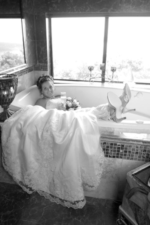 bath gown: Bride poses for wedding photo in Tub Stock Photo