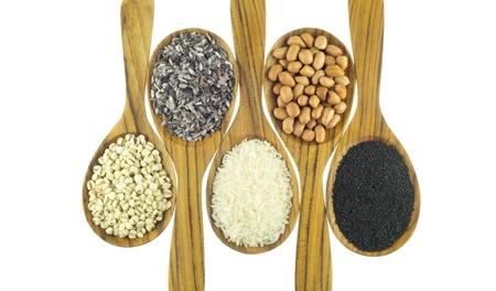 Cereals on wooden spoon Standard-Bild