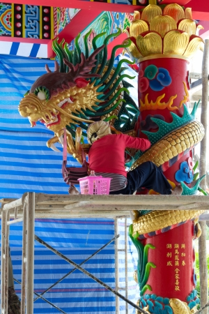 Workers paint the dragon  photo
