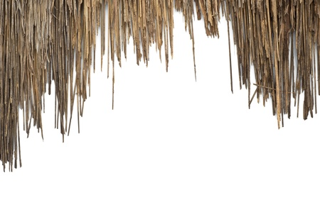 a house with a straw: The old roof made of grass on white background