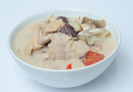 soup with chicken, galanga root and coconut photo