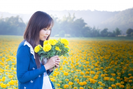 beautiful woman smelling a flower  photo