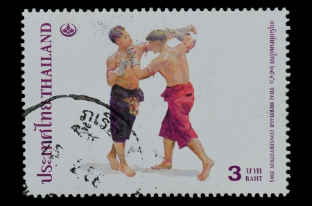 """THAILAND - CIRCA 2003  A stamp printed in Thailand ,shows Thai boxing style from the series """"THAI HERITAGE CONSERVATION"""", circa 2003   photo"""