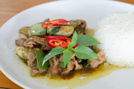Stir-fried  green curry with pork photo