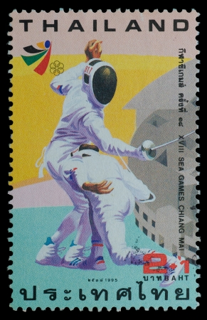 THAILAND - CIRCA 1995  A postage printed in Thailand show image of fencing  from XVIII SEA GAMES CHIANG MAI Commemorative Stamps , circa 1995