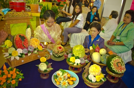 BANGKOK - August 03   Thai womens are carving fruits in Thailand 2013 World Stamp Exhibition at Siam Paragon on August 03, 2013 Bangkok, Thailand