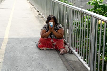 BANGKOK, THAILAND - AUGUST 04   Thailand women begging on the overpass in Bangkok ,Thailand on  August 04, 2013