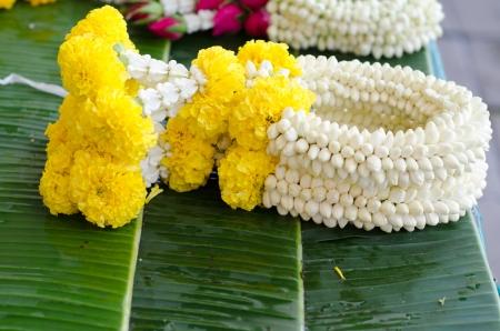 Thai style garland at flower market in Thailand photo
