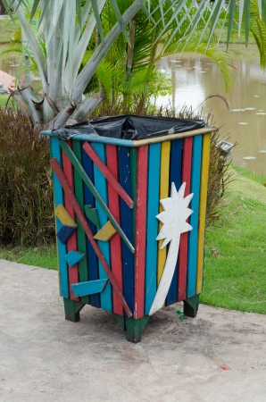 Colorful bin in the park. Trash container photo