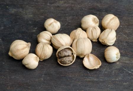 carminative: Siam Cardamom(Amomum krervanh Pierre)  dried on bamboo background Stock Photo