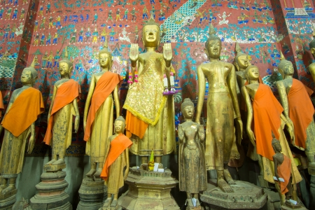 Buddha statue in Wat Xieng Thong, Buddhist temple in Luang Prabang World Heritage, Laos photo