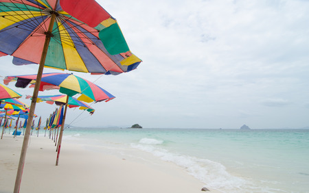 Beach chairs with umbrella and beautiful beach at Khai Nok Island, Phuket photo