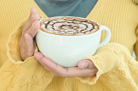 Female hands with coffee cup photo