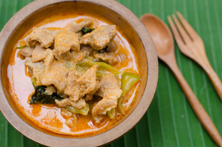 Red savory curry paste with pork and coconut milk (Panang) photo