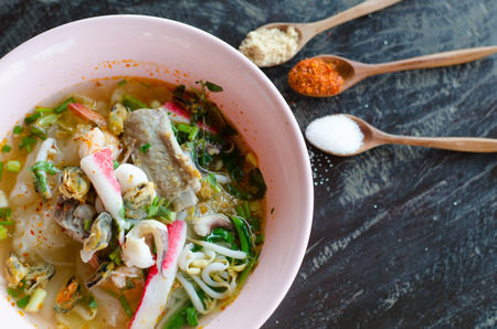 Tomyum noodle with seafood and flavoring photo