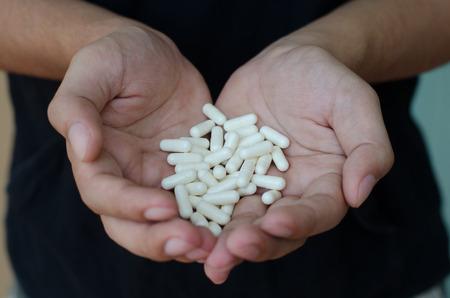 pills hand: Pills in hand