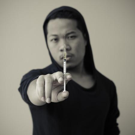 drug addict: drug addict man with syringe in hand