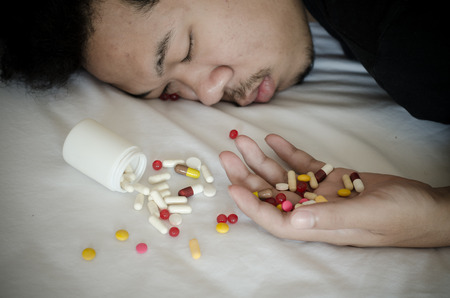 drug addict laying on the bed