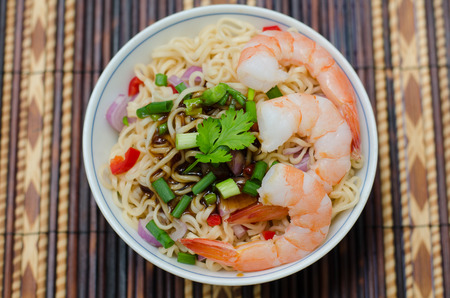 bowl of noodles with vegetables and prawn photo