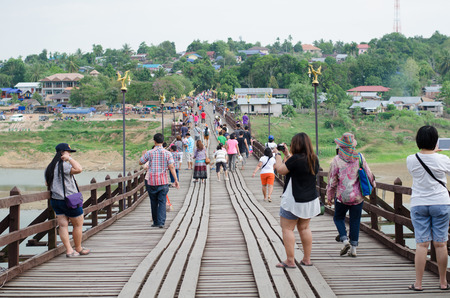 2 way: SANGKLABURI THAILAND  MAY 2 2015 : Traveler crossing wooden bridge or Mon Bridge in Sangklaburi. Kanchanaburi Thailand. Attractions traditional way of life Editorial