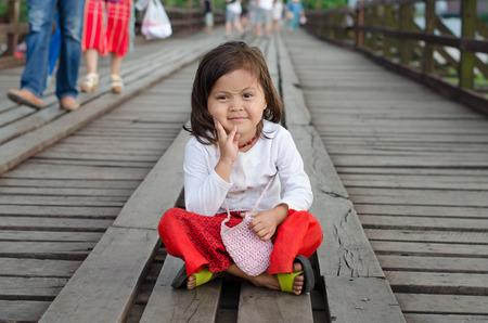 thanaka: Sangkhlaburi,Thailand-May 4: Unidentified young asian girl with thanaka powder on face of this mon identity on May 4, 2015 Mon village in Sangkhlaburi,Thailand.