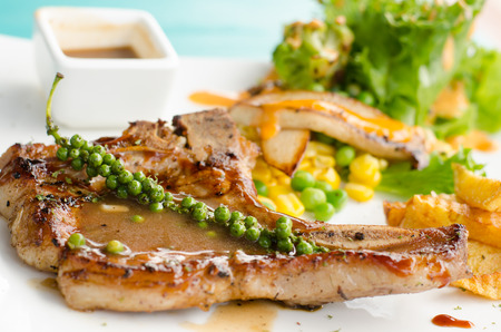 tbone: grilled t-bone steak and vegetables