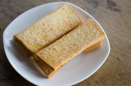 sweet and savoury: Bread  bake on white dish Stock Photo