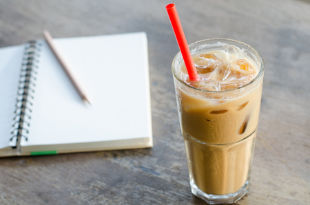 cold beverages: Glass Of Cold Coffee On Wood Table Stock Photo