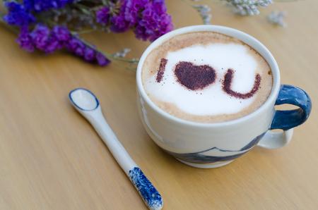 i love u: hot coffee with foam milk art I LOVE U pattern