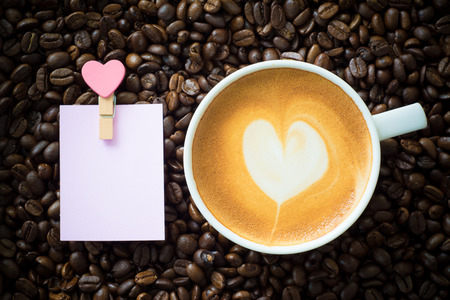 valentine day cup of coffee: hot coffee on coffee bean background