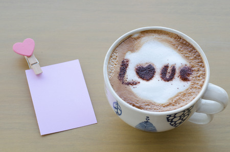 valentine day cup of coffee: hot coffee with foam milk art love pattern Stock Photo