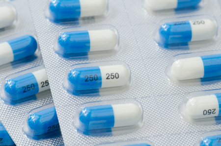 antimicrobial: Dicloxacillin capsule in blister pack Stock Photo